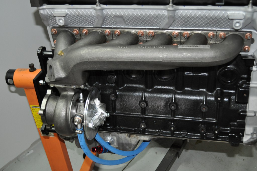 11 in addition Addicted To Boost Pt 2 besides Mercedes W107 Widebody Nurburgring besides Watch together with Ultimate Power Play Part Ii 5 More Hot Engine Swaps. on 2jz turbo kit